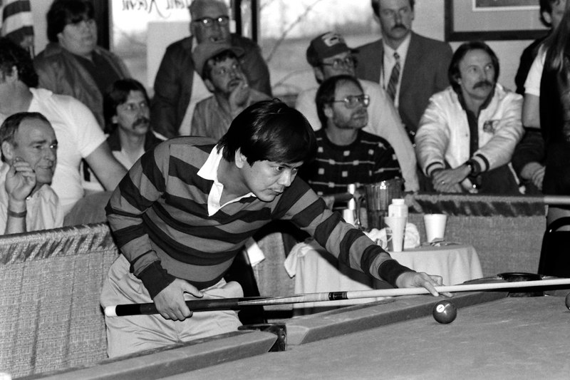 Jose Parica won the 9-Ball event. This photo made the cover of Billiard News.