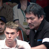 Efren Reyes is moving and thus a bit blurred. Corey Deuel watching. I believe that is Cue Collector and player Charlie Flip just behind Corey.
