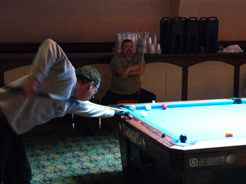 Earl Strickland with Bill Vanover watching during this bank pool match.