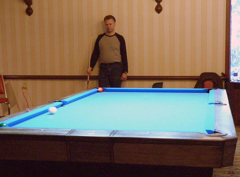 Gary Robbins wins the match as the three ball drops; his opponent looks on.