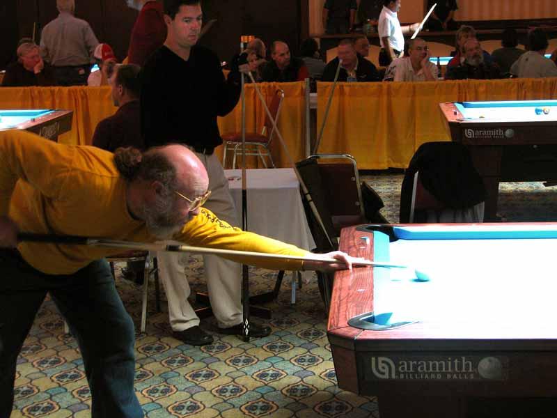 Howard Vickery shoots as John Schmidt watches