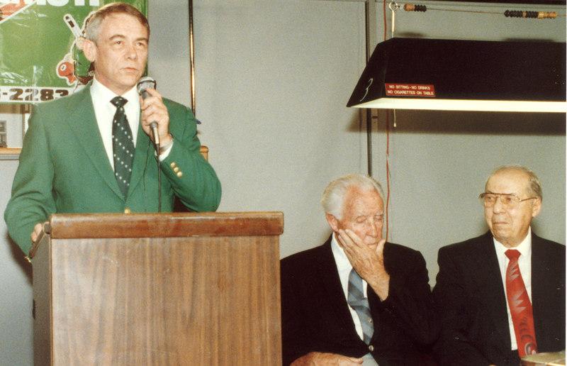 Rick Boling at the mike; Willie Mosconi and Jimmy Caras seated