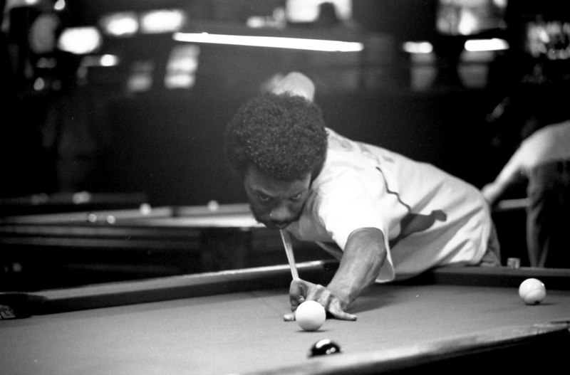 Eddie Brown as identified by none other than Eddie Brown! However, a close review of all the evidence suggests to me that this player is Ben Tubbs of Dallas. He is said to be an expert at cue tip repair and 3-Card Monte.