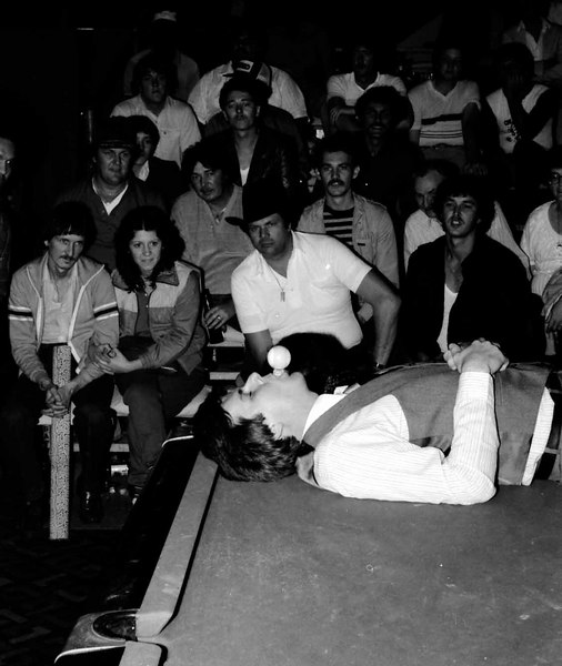 Jim Rempe B&W trick shot #2 - Walter Glass watching and holding his Fellini style cue case