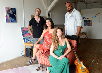 Tania Barricklo-Daily Freeman                      Jasmine Mitchell, seated right, the curator of hte upcoming Pop Up Art Garten at Ole Savannah, sits with a few of the artists that will be featured at the event: painter Ryan Myers of Kingston, left, jazz musician Maiko Hata of Kingston, center, and  multi -media artist  Felix Olivieri of Rifton.