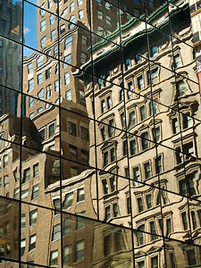 """Abstract City"" Old New York City buildings reflected off a modern glass building."