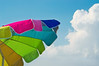 """Beach Umbrella"" A colorful beach umbrella contrasted against a blue sky."