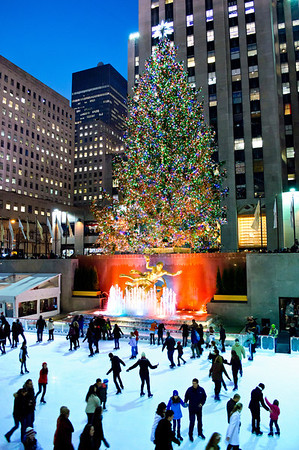 """Ice Skating Rink, Rockefeller Center 2012"" NEW YORK - DECEMBER 14: Ice skaters enjoy the rink around the famous Rockefeller Center Christmas tree at night on December 14, 2012 in New York City."