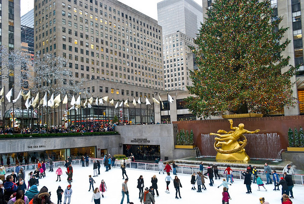 """Holidays Rockefeller Center""  NEW YORK - DECEMBER 26: Ice skaters and tourists are all around the famous Rockefeller Center Christmas tree on December 26, 2011 in  New York City."