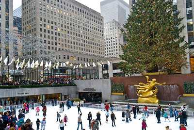 """""""Holidays Rockefeller Center""""  NEW YORK - DECEMBER 26: Ice skaters and tourists are all around the famous Rockefeller Center Christmas tree on December 26, 2011 in  New York City."""