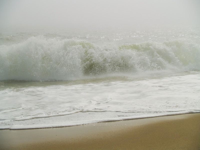 The braking waves and surf along the coastline of the Jersey Shore.