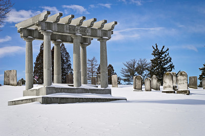 Frsh snow on the graves and large memorial in The Old Tennent Cemetery in Central New Jersey.