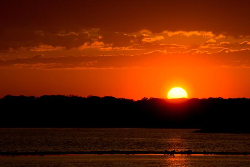 """Warm Sun"" 2011<br /> The sun setting over the Shark River in Belmar, along the Jersey Shore."