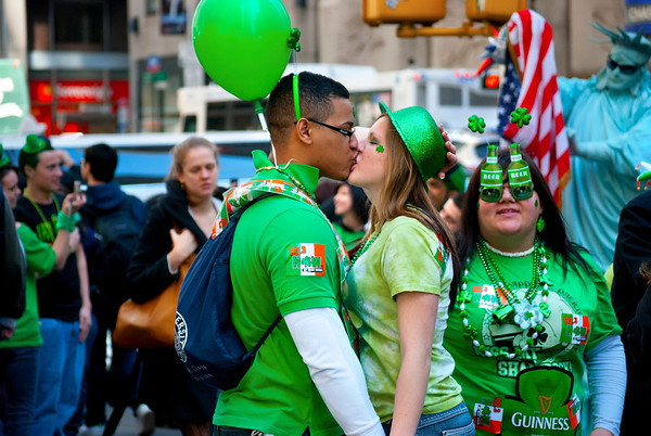 NEW YORK - MARCH 17: A couple kisses near the St. Patrick's day parade on March 17, 2011 in New York City.