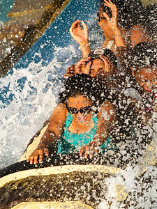 """Splash Down"" Kids enjoy the splash down on the log flume ride at Six Flags Great Adventure in New Jersey."