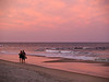 A couple walks along the beach at sunset in Ocean Grove, along the Jersey Shore.