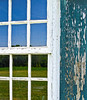 """Section Reflection"" An old window with peeling paint reflects a Summer field in New Jersey."