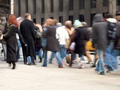 """Moving Crowd"" People walking on the streets of New York with a motion blur effect."