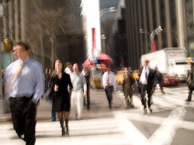 People walking on the streets of New York with a motion blur effect.