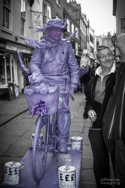 Purple with anger doesn't seem to fit here.  Although Mr Mauve does seem to be giving a rather stern look to the chap who has captured his friend's/sibbling's attention.<br /> <br /> Are these chaps twins?<br /> <br /> I saw them in the shambles and thought they must be at least brothers if not twins.