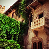 A young lady waves to friends on Guilette's Balcony, Verona Italy.