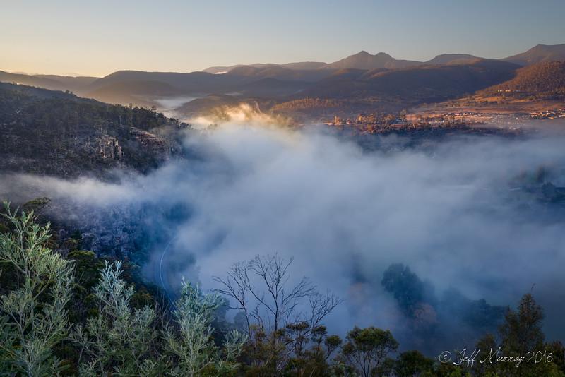 Sunrise hits the mist