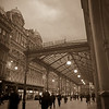 A shot in rush hour at the front front of Glasgow Central Station.<br /> <br /> It's the sepia version of the HDR posted earlier.  My family liked this version the best.