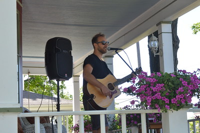 Mark Daisy performs as spectators watch at Mt. Pleasant on Sunday. Daisy was one of many musicals acts who performed on 14 different volunteer homes as part of PorchFest.