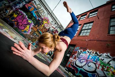 Yogi practicing in Graffiti Alley in Baltimore City.