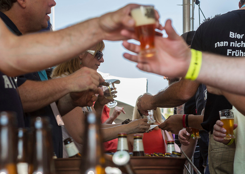 Erik Anderson/Rockford Register Star<br /> Festival workers and attendees trade off for empty and filled glasses of beer at one of the many tents during the third annual Screw City Beer Festival in downtown Rockford on Saturday, September 7, 2013. The SCBF hosts over 130 different types of beers and will bring about 2,000 enthusiasts during its one day duration.