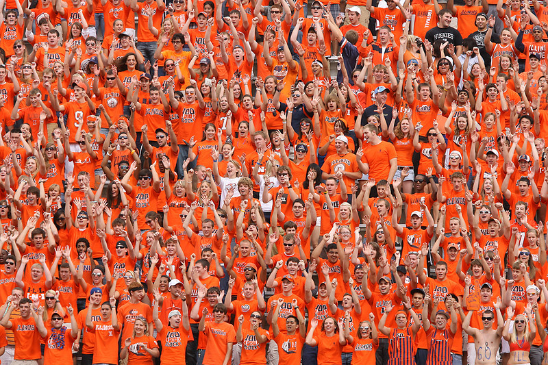 Erik Anderson | The Northern Star<br /> Two Northern Illinois University fans (top right) stand engulfed by Illinois fans in the student section during the match up of the Huskies and the Illini at Memorial Stadium in Urbana-Champaign on September 18, 2010.