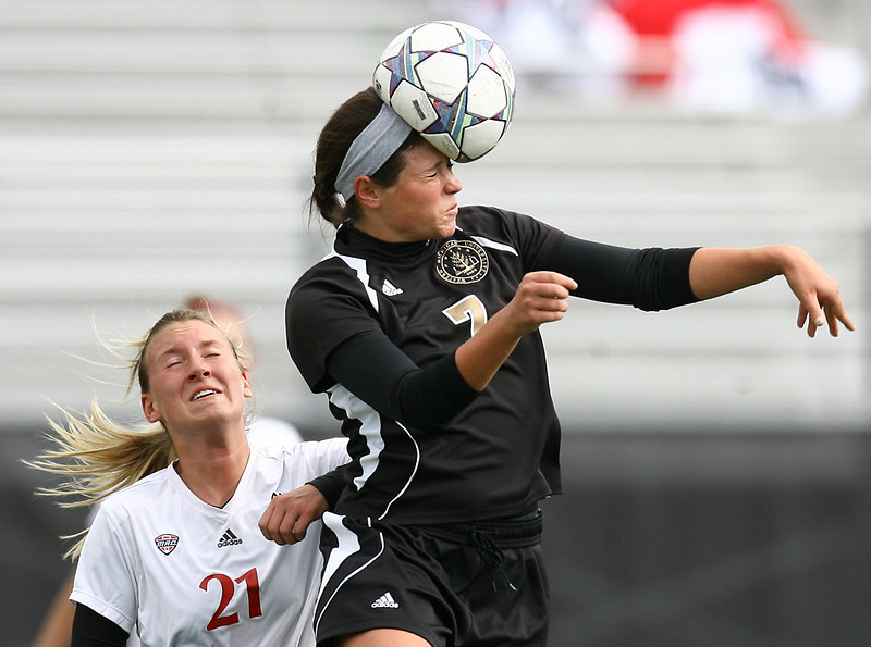 Erik Anderson | The Northern Star<br /> Northern Illinois University forward Samantha Hill shoves Western Michigan midfielder Megan Putnam Thursday, October 27, 2011 at the NIU Track and Field complex in DeKalb. Western Michigan would go on to beat Northern Illinois 2-0.