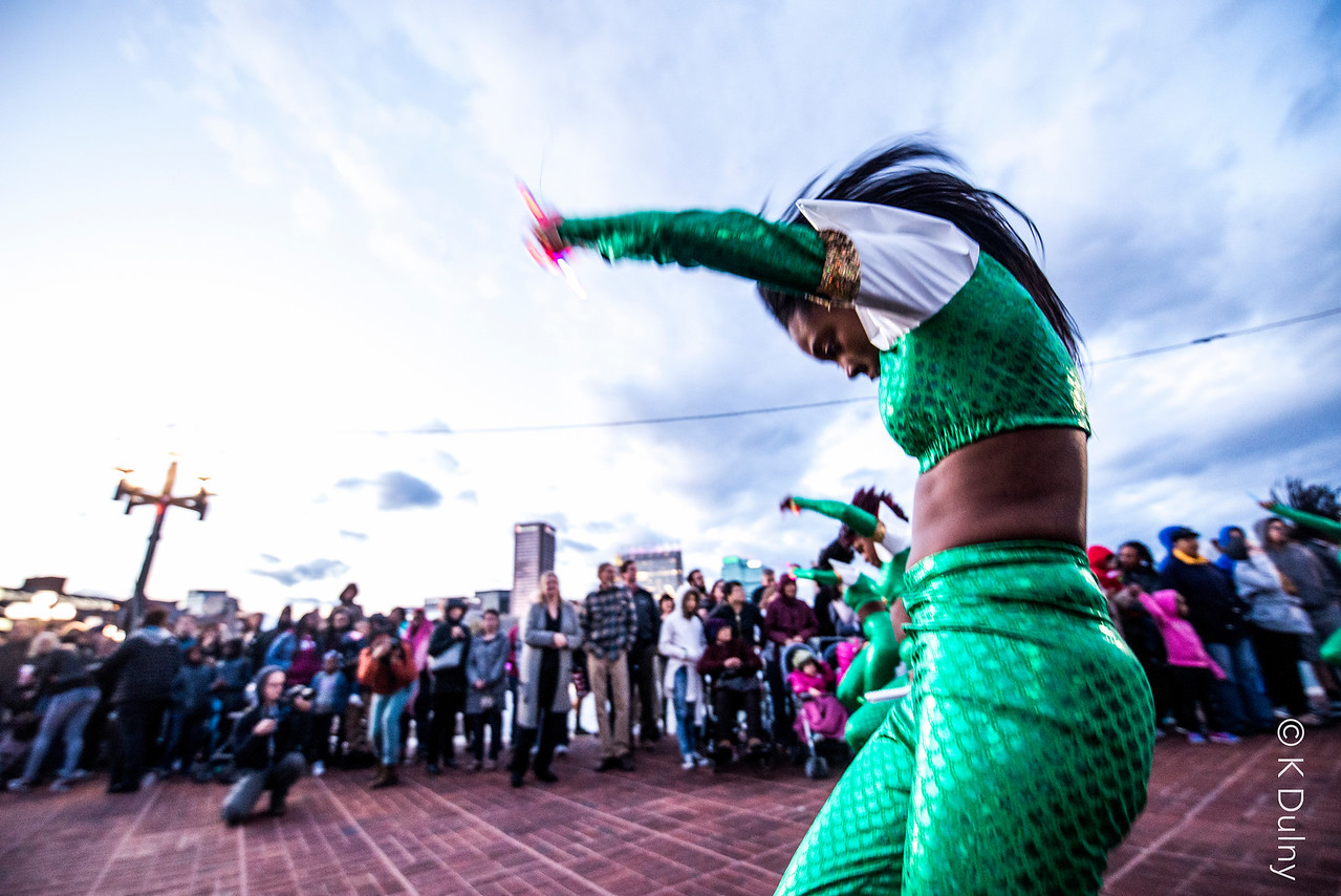 """Women dancing in the opening parade of """"Light City Baltimore"""""""