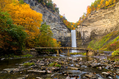 Taughannock Falls Gorge with Footbridge Creek at Sunrise In Full Fall Colors On Foggy Day