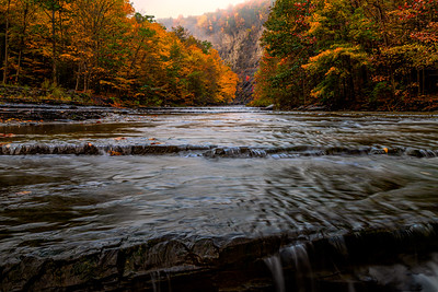 Taughannock Falls Creek at Sunrise In Full Fall Colors On Foggy Day