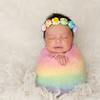 Newborn Baby Girl With Rainbow Colored Swaddle