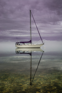 Calm Sailboat On Cayuga Lake Against The Storm