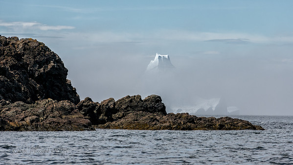 Iceberg and incoming fog