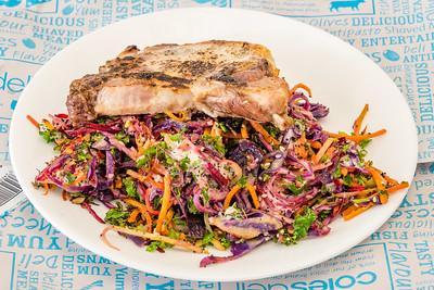 Tuesday dinner. Roasted pork chop with stir-fried kale slaw.