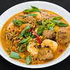 Curry prawns with pork beef meatballs