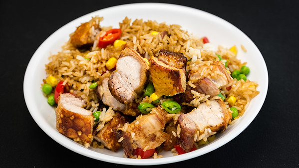 Roast pork rashers with crispy crackling and rice