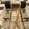 "Basically, the idea is to allow the body to move near it's ""mid"" point on each body side panel. This technique has proven to work quite well in reducing the effect of the body CG on the chassis."
