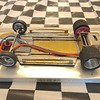 "The chassis is made from .032"" brass sheet. the main rails are .062"" piano wire and are cut apart in the center of the chassis to reduce the torsional stiffness of the chassis. Motor bracket is a Warmack sidewinder bracket."