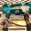 "This view shows the body mounting slots on each side of the chassis. Note the brass angle brackets on each side of the body. The body brackets fit into the slotted body mounts on each side of the chassis. This body mounting technique was created/implemented by Hector ""Gonzo"" Gonzalez for many of his very fast hardbody cars."