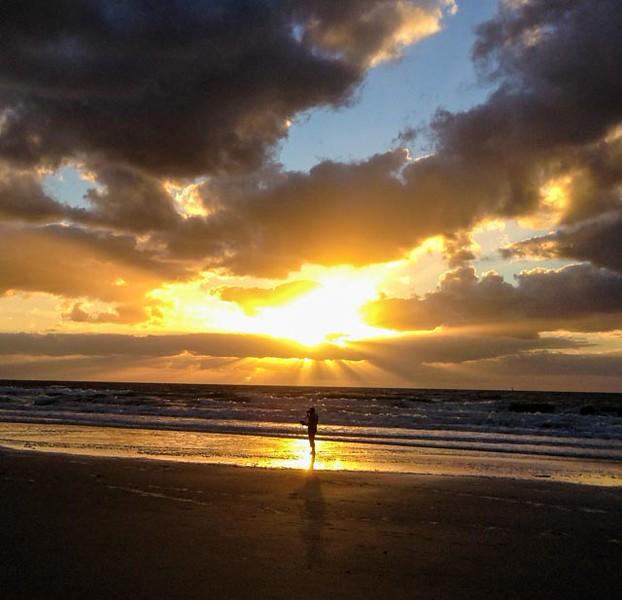 A lone beach walker again.