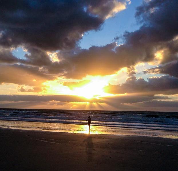 A lone beach walker