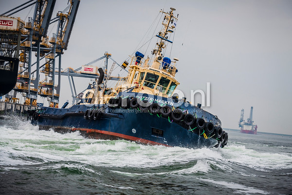 Tugboat playing around in Port of Rotterdam