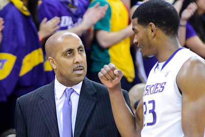Lorenzo Romar - Head Coach of the Washington Huskies take with Guard C.J. Wilcox during the game vs. the Arizona Wildcats at Alaska Airlines Arena, January 31st 2013.