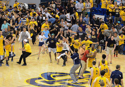 Crowd rushes the court after a UC Irvine win over Long Beach State, March 13, 2013. Matthew Lamb
