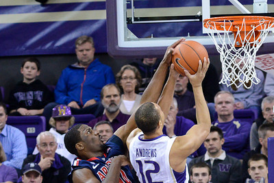Arizona Wildcats Solomon Hill blocks a shot by Washington Huskies Andrew Andrews in 57-53 Washington loss to Arizona at Alaska Airlines Arena, January 31st 2013.